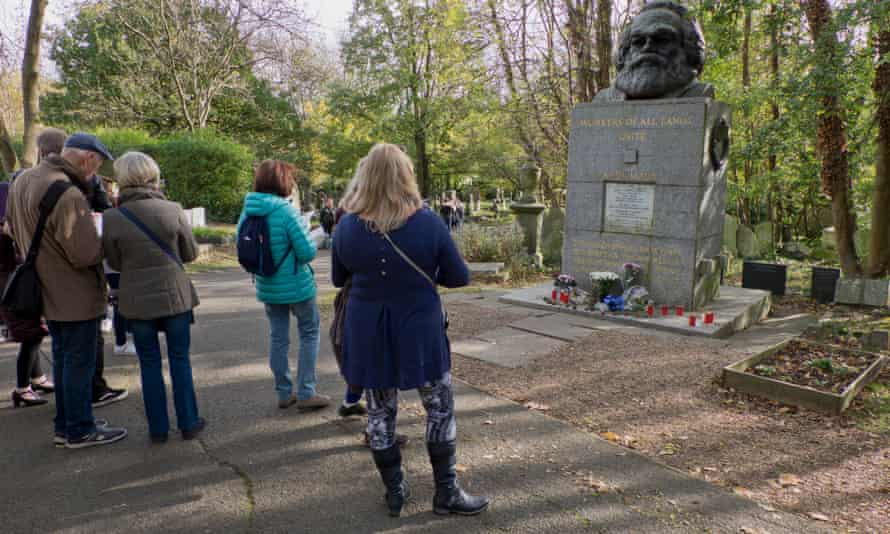 Visitors to Karl Marx's grave, Highgate Cemetery, London.