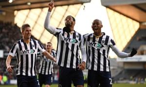 Millwall's Shaun Cummings, centre, celebrates scoring.