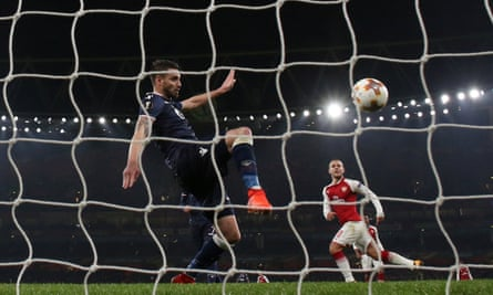 Red Star Belgrade's Damien Le Tallec somehow clears Jack Wilshere's dinked finish off the line to deny Arsenal victory in the Europa League.