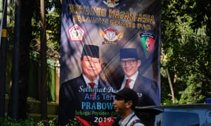 A poster showing Indonesian one-time presidential candidate Prabowo Subianto, left.