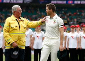 Australia's Tim Paine speaks to Ku-ring-gai Fire Brigade volunteer John Corry at the third Test against New Zealand at the SCG.