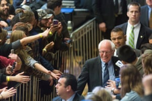 Bernie Sanders walks through the crowd to the stage.