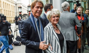 Cliff Richard and the television presenter Gloria Hunniford arrive at the high court in London.