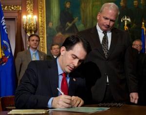 Wisconsin Governor Scott Walker signs a bill