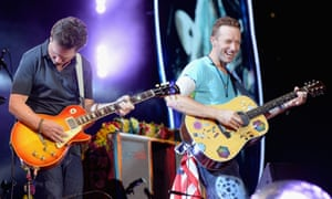 Michael J Fox joins Chris Martin onstage in New Jersey.