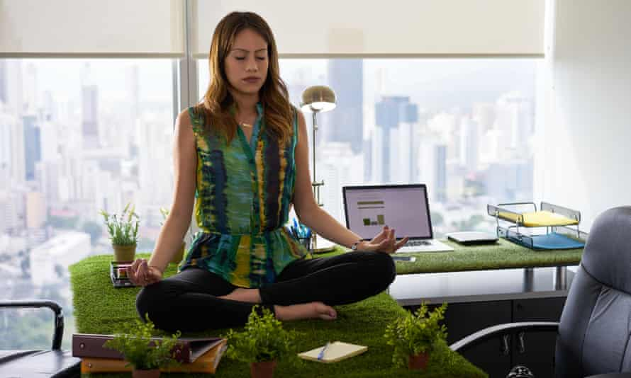 Young hispanic woman in office, sitting on desk covered with grass and plants