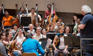 'We prove the cliche that music is an international language' … the BE PHIL amateur orchestra rehearsing with Simon Rattle in May.