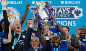 Leicester City captain Wes Morgan and manager Claudio Ranieri lift the trophy as the team celebrate.