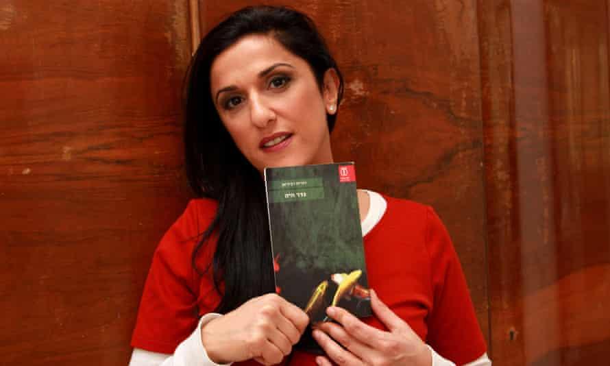 Israeli author Dorit Rabinyan with her book Borderlife.