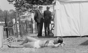A woman sunbaths at Henley Royal Regatta in Oxfordshire