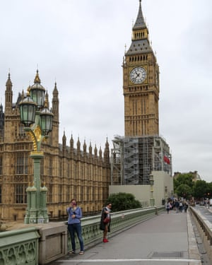 People take selfies with Big Ben before the bell falls silent for a period of repair work.