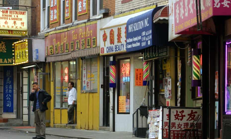 A man makes a cellphone call on an empty Chinatown street in November 2001.