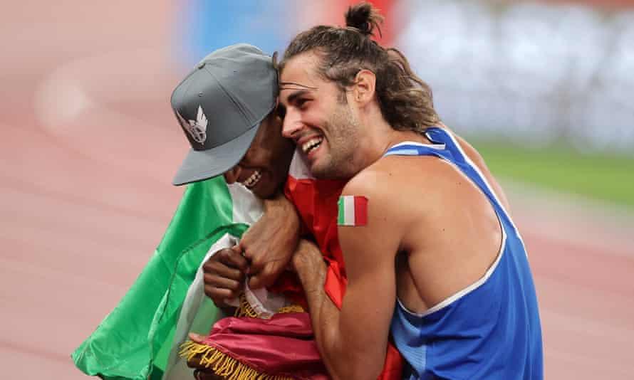 Mutaz Essa Barshim of Qatar and Gianmarco Tamberi celebrate after both winning gold in the men's high jump.