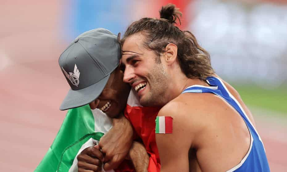 Mutaz Essa Barshim of Qatar and Gianmarco Tamberi of Italy celebrate after winning gold in the men's high jump final at Tokyo 2020 Olympic Games