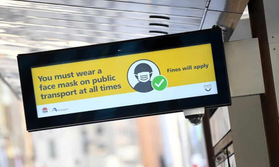 A sign on a light rail service in Sydney on 18 January warns passengers to wear a face mask.