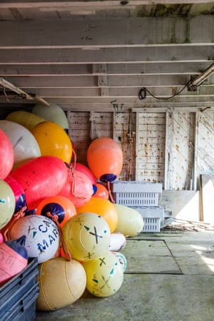 A fishing shack filled with colorful buoys in Cape Forchu.