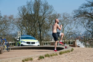 Local resident Adam exercises alongside a heavy police presence on Primrose Hill during the  lockdown
