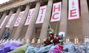 Flowers and banners outside St George's Hall, Liverpool