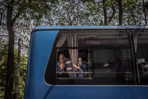 Wuhan, China Medical workers from Shandong province wave from a bus as they leave the city after they were drafted in to help with the outbreak
