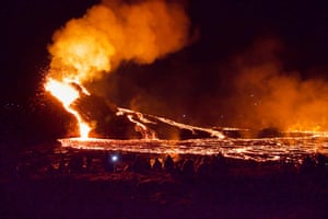 Reykjavik, Iceland: Hikers look at lava flowing from the erupting Fagradalsfjal volcano, which erupted for the first time in 800 years.