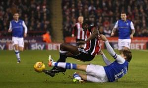 Wednesday's Glenn Loovens goes through United's fouls Clayton Donaldson in last season's derby.