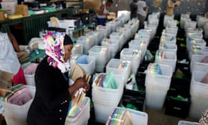 A Kenyan election officer in Nairobi prepares ballot boxes before they are transported to different polling stations.
