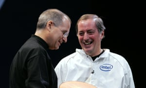 Former Apple CEO Steve Jobs, left, smiles with former Intel Corp CEO Paul Otellini during the MacWorld conference in 2006, the year Intel processors were introduced to Mac computers.