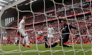 Man United's David De Gea makes a save from Liverpool's Georginio Wijnaldum.