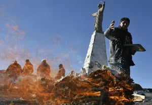 La Paz, Bolivia A Yatiri (Aymara priest) performs an Andean ritual burning sullus (llama fetus) to thank the Pachamama (Mother Earth). Bolivia worships during August the Andean goddess, Pachamama