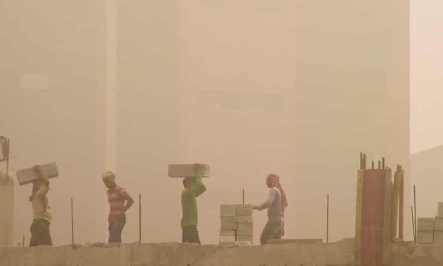 Labourers work on a Delhi construction site.