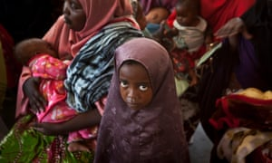 Somali mothers wait for their children to receive a five-in-one vaccine against potentially fatal childhood diseases at a health centre in Mogadishu