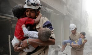 Members of the White Helmets rescue children after an airstrike in Aleppo