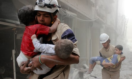 Syrian civil defence workers rescue children in Aleppo