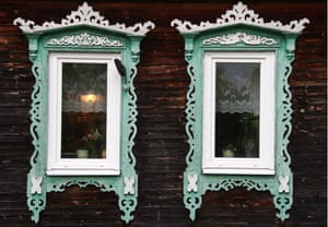 Rostov, Russia: Traditional wooden window frames   decorate houses in the town
