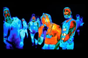 The rapper Travis Scott (centre) performs via thermal technology cameras alongside Tomo Miličević (left) and Jared Leto (right) of the band Thirty Seconds to Mars, during the 2017 MTV Video Music Awards at The Forum, Inglewood, California, US