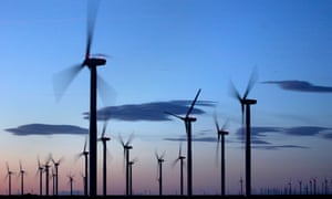 Wind turbines silhouetted against the sky