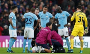 Manchester City players look on as Kevin De Bruyne receives treatment after a heavy challenge by Jason Puncheon, who only received a yellow card.