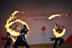 Performers show their skills before the arrival of the Olympic torch in Minamisoma, Japan