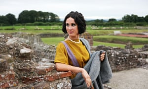 A woman in Roman British-style dress and makeup