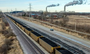 A train of loaded coal cars heads to the Oak Creek power plant in Oak Creek, Wisconsin, earlier this month.