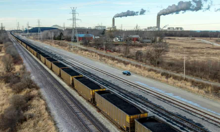 A train of loaded coal cars heads to the Oak Creek power plant in Oak Creek, Wisconsin, earlier this month.