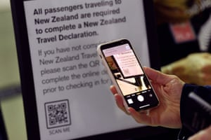 AUSTRALIA-NZEALAND-HEALTH-VIRUSA passenger scans a barcode to complete travel declarations for New Zealand flights at Sydney International Airport on April 19, 2021, as Australia and New Zealand opened a trans-Tasman quarantine-free travel bubble. (Photo by SAEED KHAN / AFP) (Photo by SAEED KHAN/AFP via Getty Images)