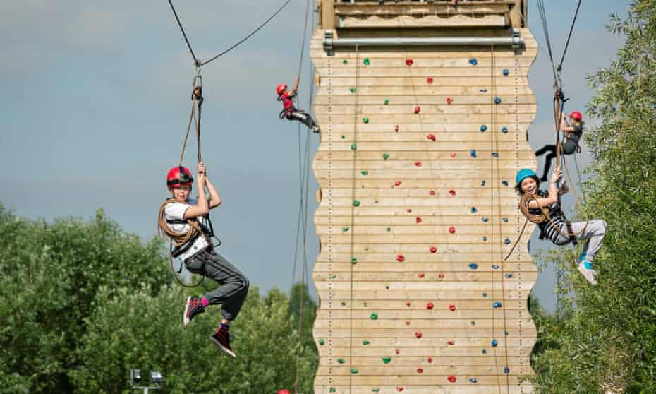 Kids on climbing wall and zipwires at Kingswood Dearne Valley, South Yorkshire.