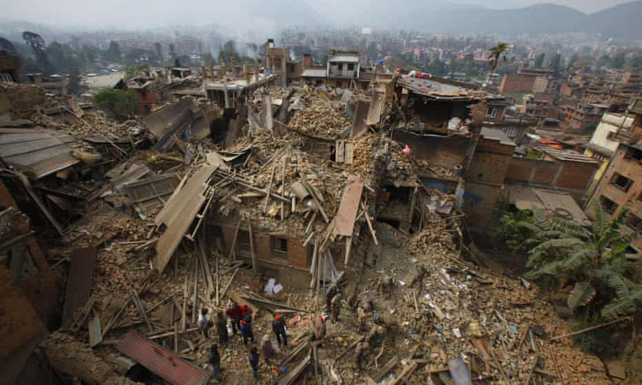 Rescue workers remove debris as they search for victims of the earthquake in Bhaktapur near Kathmandu, Nepal.