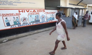 A woman looks at posters displaying information about HIV and Aids at a hospital in Liberia