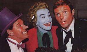 Burgess Meredith as the Penguin, with Cesar Romero as the Joker and Adam West as Bruce Wayne in Batman (1966).