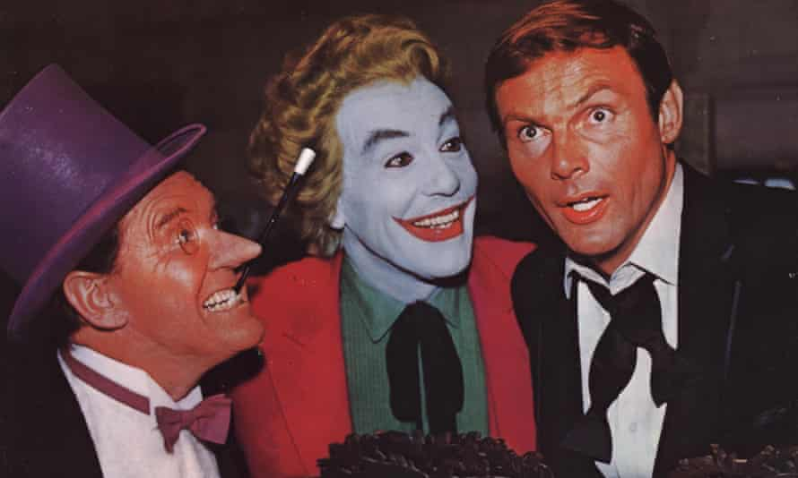 Burgess Meredith as the Penguin, with Cesar Romero as the Joker and Adam West as Bruce Wayne in Batman (1966).