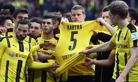 Bayern Munich held to a draw while Borussia Dortmund claim emotional win