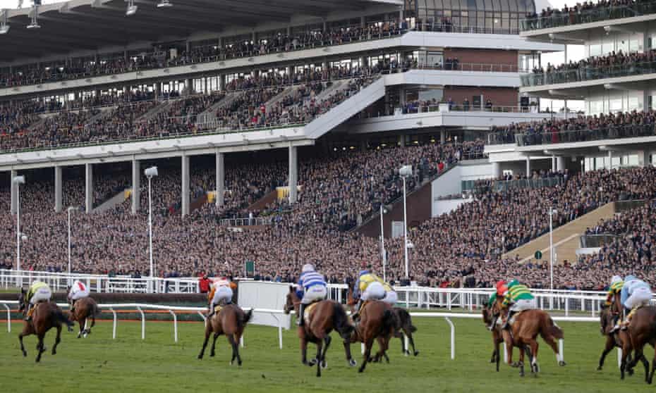 Packed crowds watch last month's Cheltenham Gold Cup, which went ahead despite coronavirus concerns.