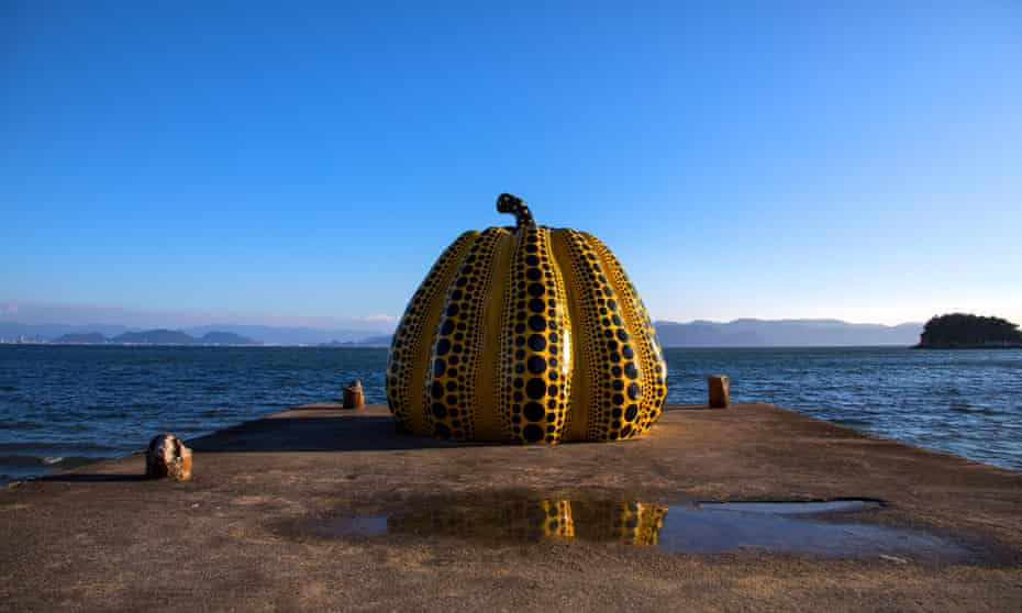 Yayoi Kusama's pumpkin sculpture on pier , Seto Inland Sea.